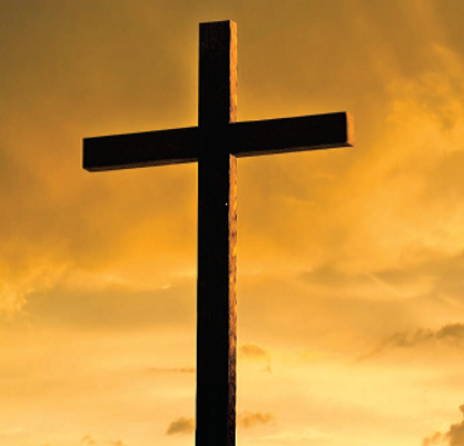 Cross with sunset background.png