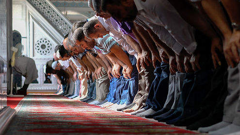 Muslim Men bowing in prayer__Sept Oct 20