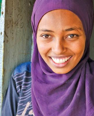 Muslim woman in purple hijab.png