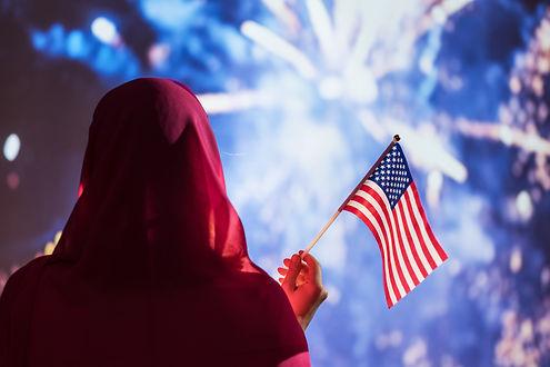 Muslim woman with American Flag__AdobeSt