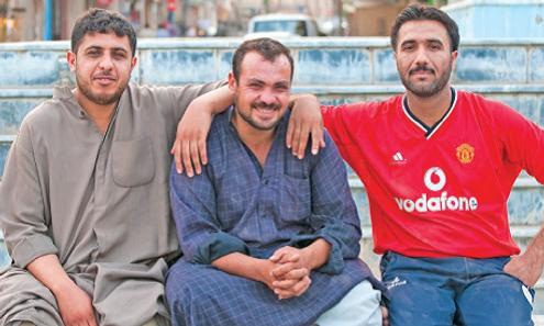 Three men sitting.png