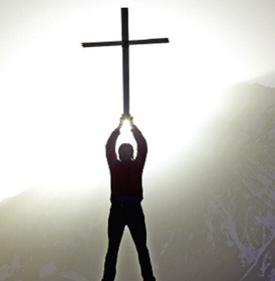 Man holding a Cross.png