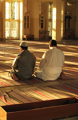Two Men in Mosque.png