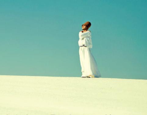 Muslim man in desert.png