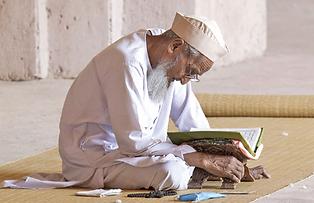 Old Muslim Man with Koran.png