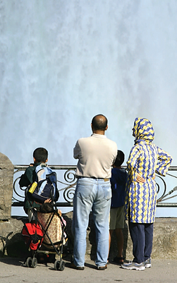 Muslim Family looking at waterfall.png