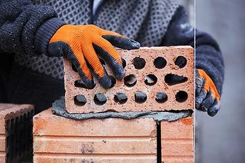 person holding brick