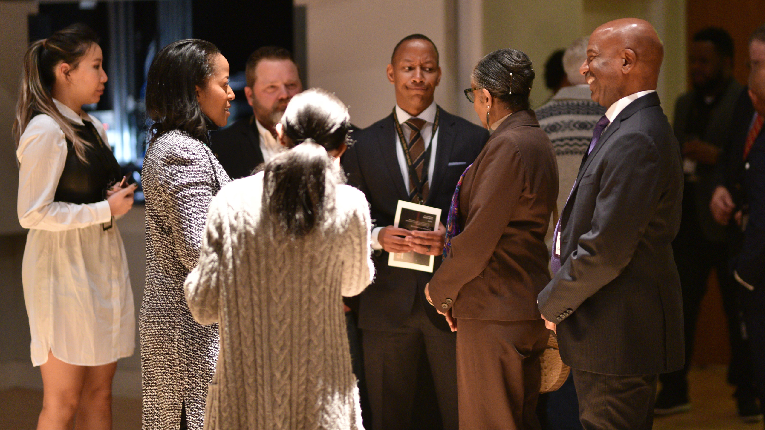 Event attendees standing and socializing