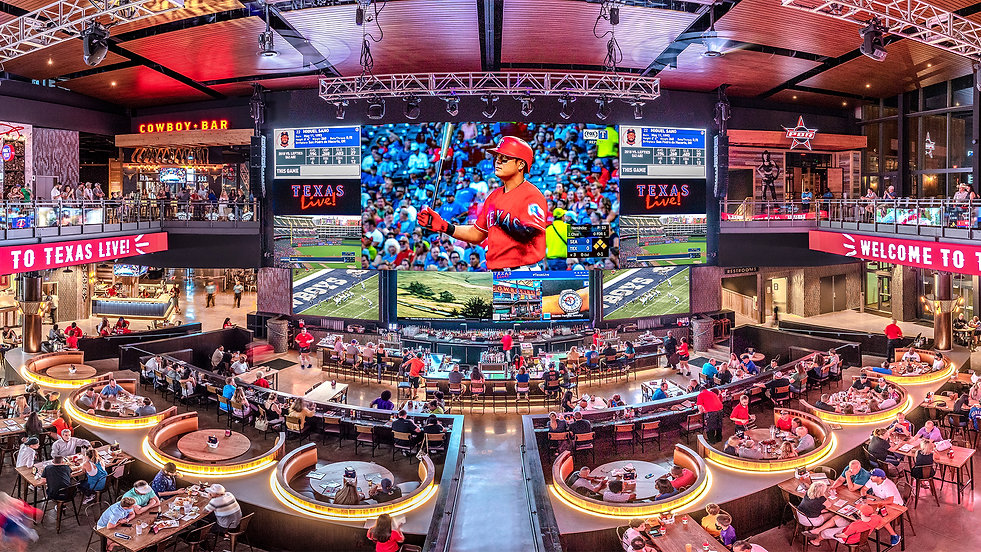 Interior of Texas Live! in Arlington, TX. View from the second floor, tables and booths ar