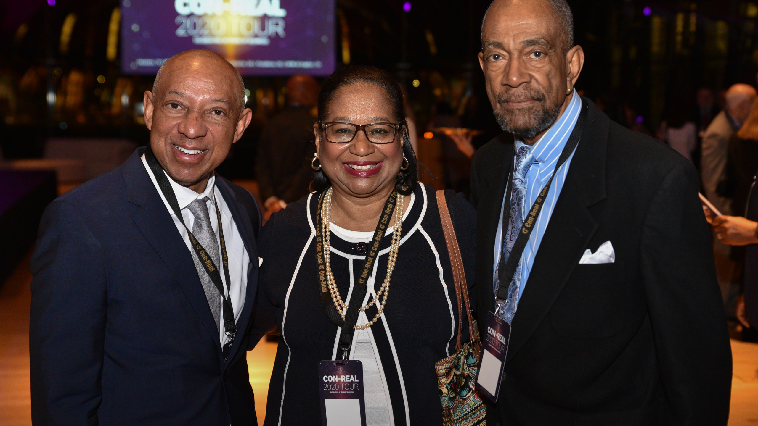 Con-Real CEO Gerald Alley with two event attendees