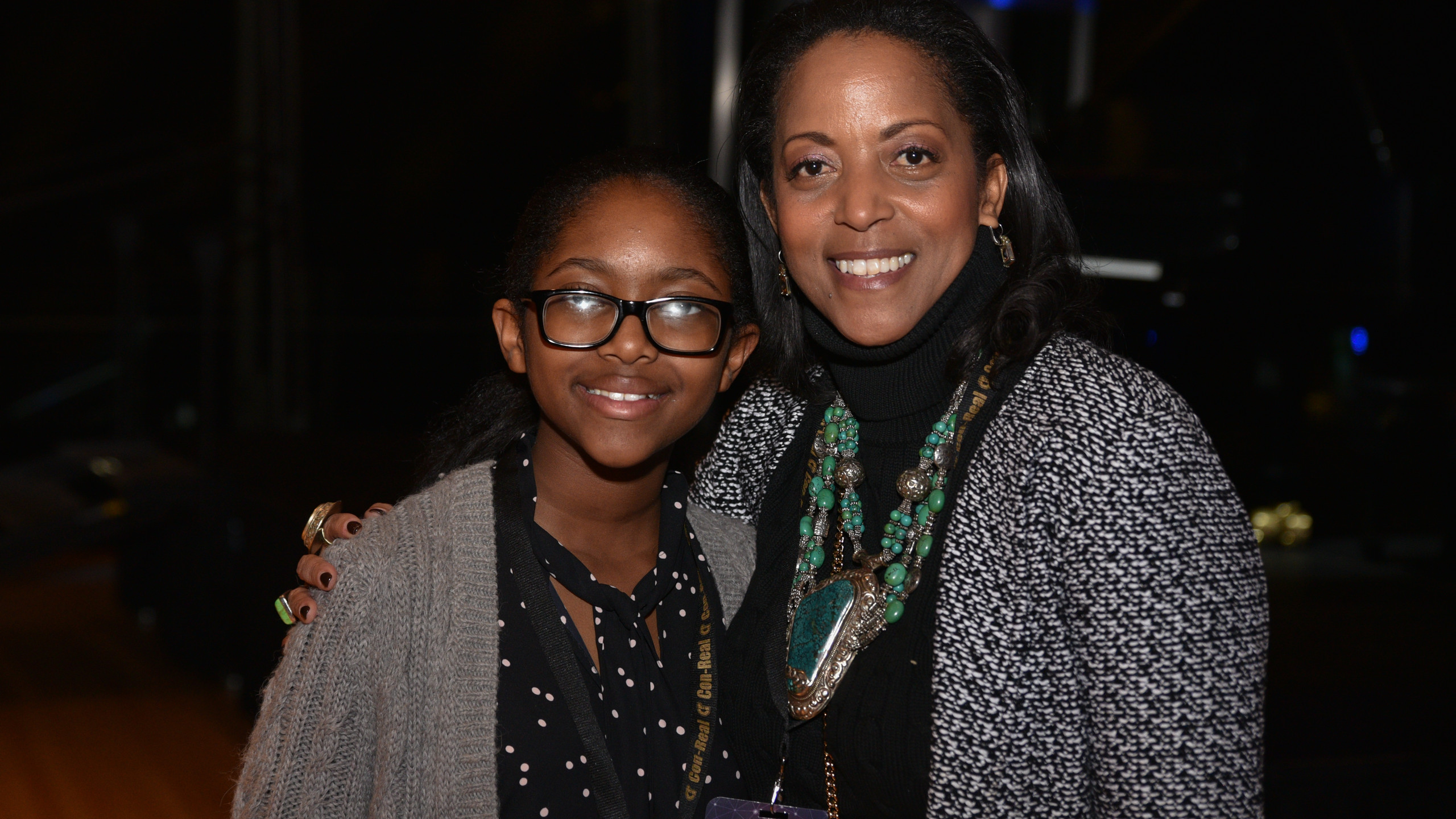 A black woman and young black girl at the event