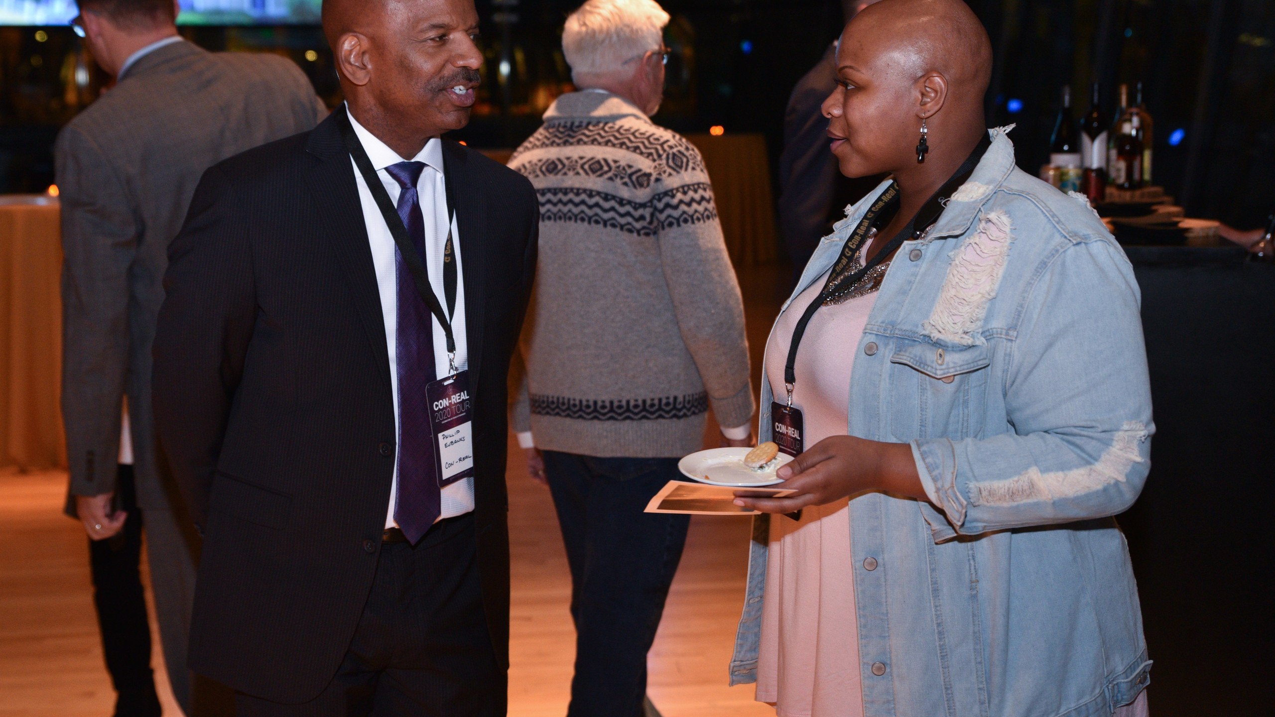 Two event attendees talking
