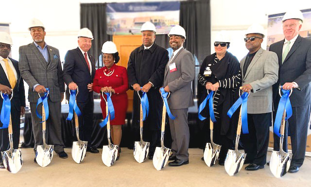 Members of the Con-Real and LSC Houston teams holding shovels at the groundbreaking event