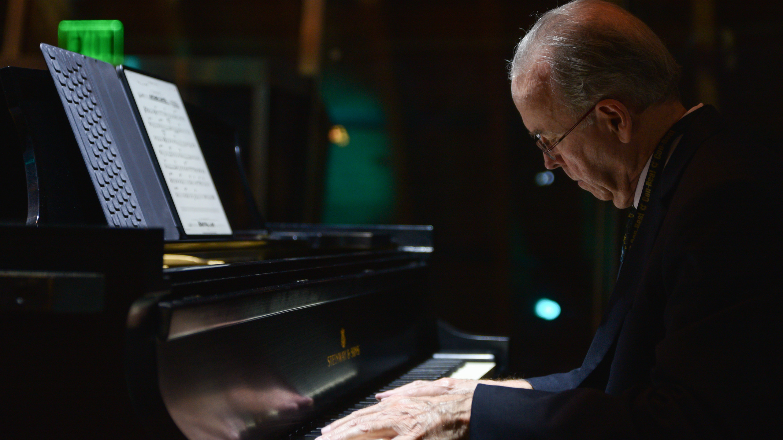 Older white man playing the piano