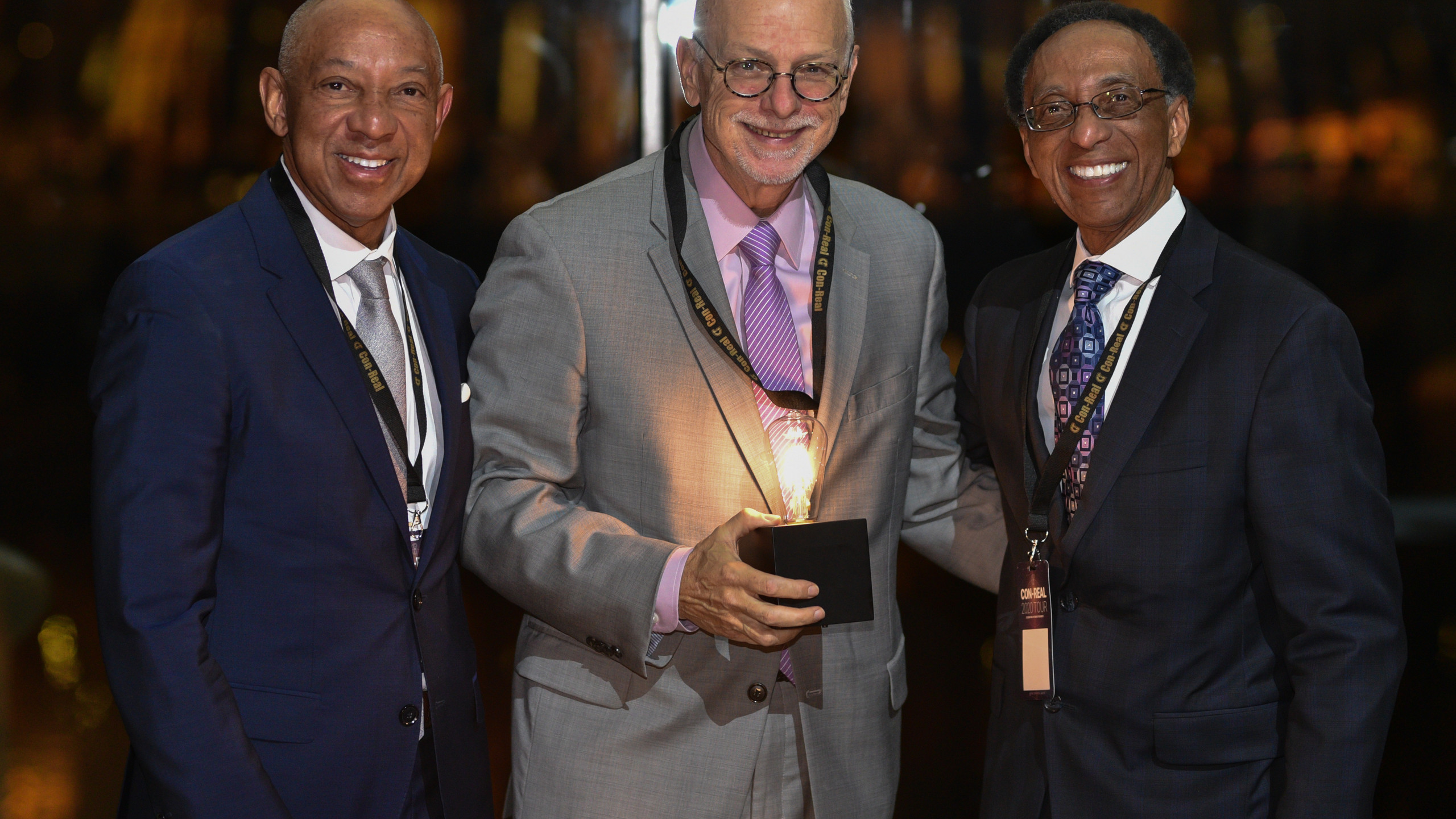 Con-Real founders Gerald and Troy Alley with award recipient