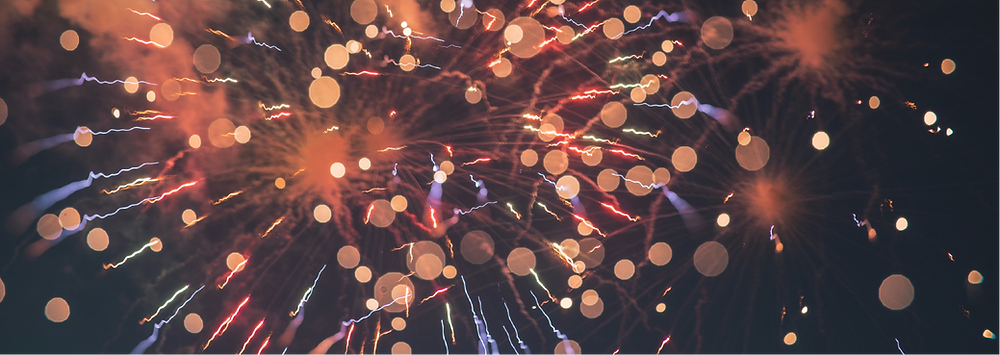 An image showing in-focus and out-of-focus fireworks