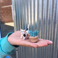 small charms in hand.JPG