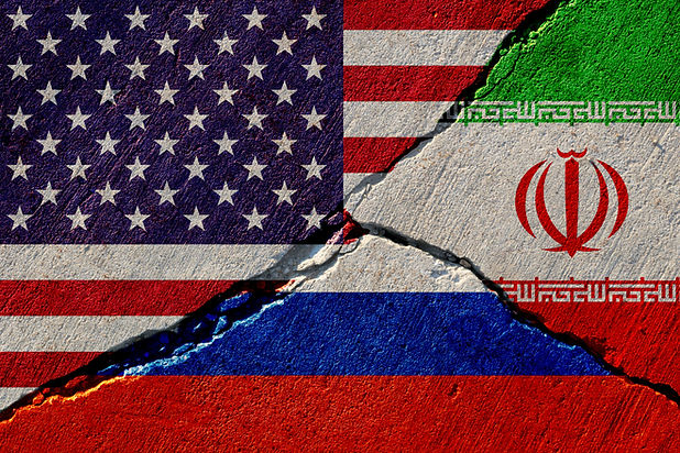 concrete wall with painted united states, russia and iran flags.jpg