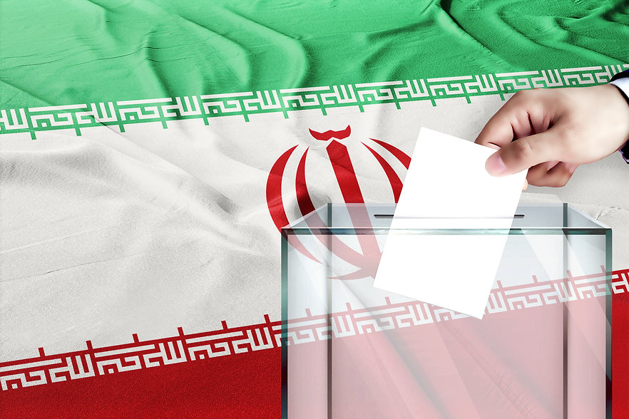 iran flag, iran  the symbol of elections Male hand puts down a white sheet of paper with a