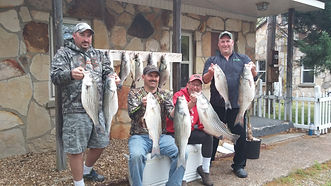 Four handsome guys with stripers.JPG