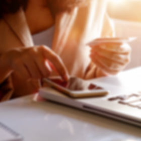 Woman Holding credit card and inputting