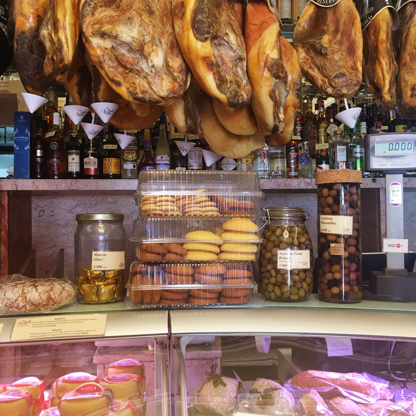 Shopping for Portuguese cured meats and cheeses at Manteigaria Silva  at Man at Manteigaria Silva