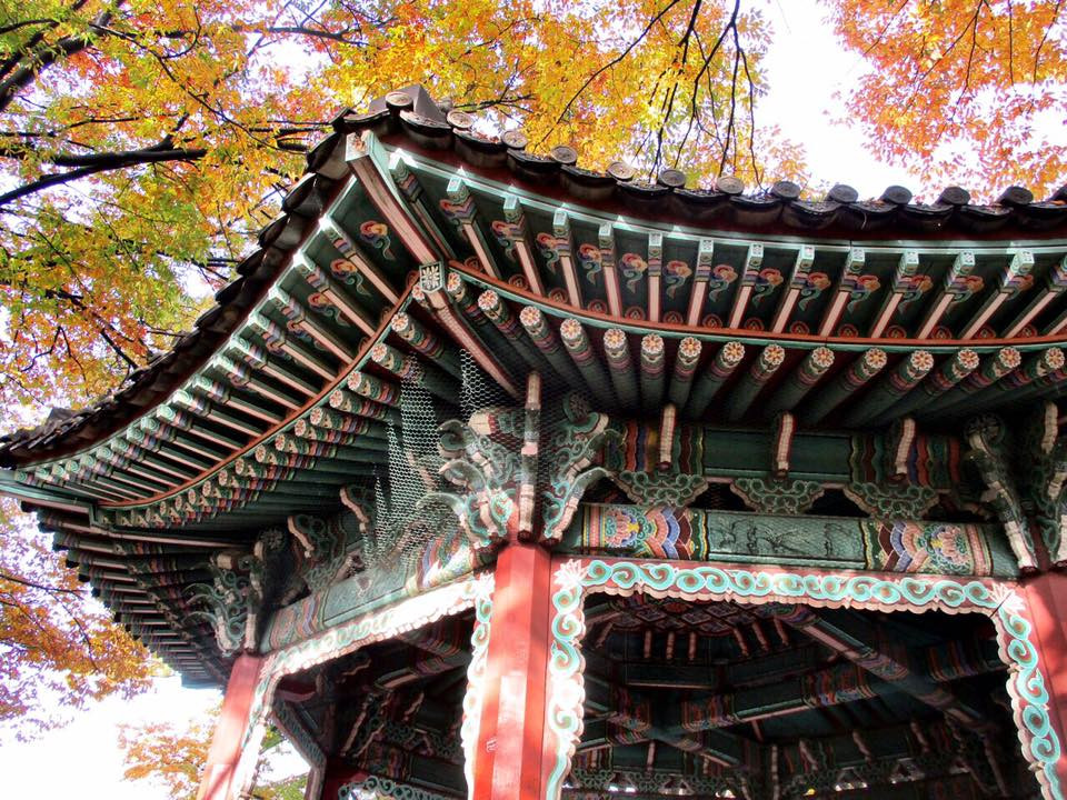 traditional pavilion at the top of Mt. Namsan in Seoul with trees turning colors in the fall