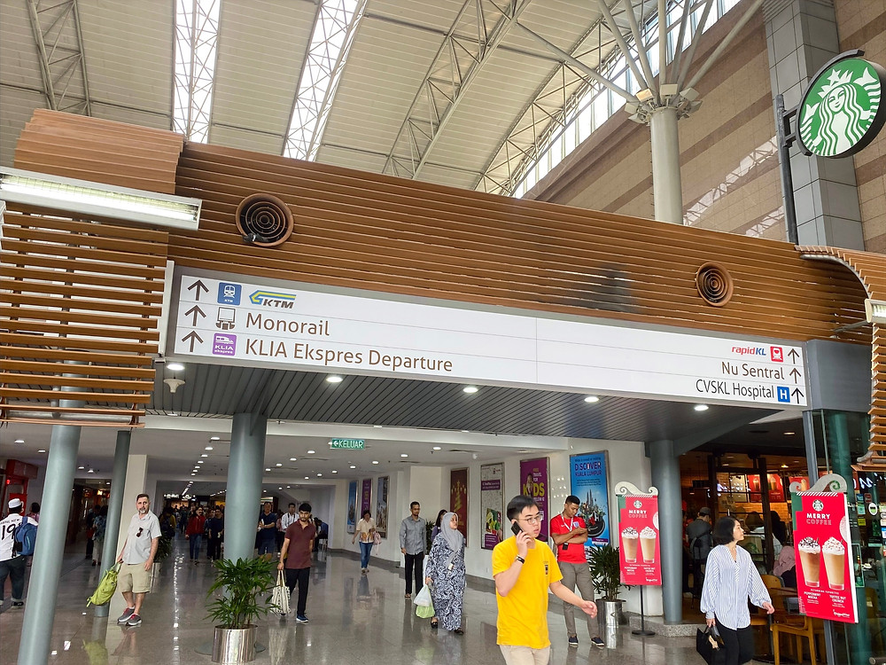 Here's a look inside KL Sentral, the largest train station in Malaysia. As you can see from the sign, this station offers train service around the city and country (via KTM rail), in the city (via the monorail), and express service to the airport (KLIA Express)
