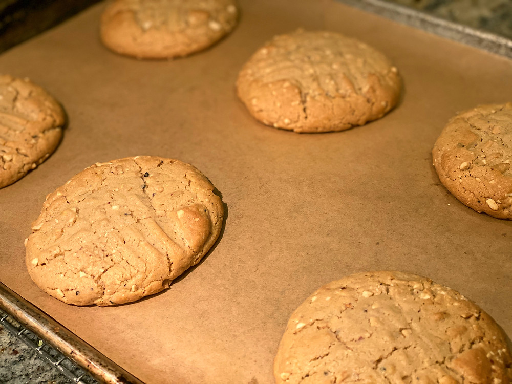 Baking a batch of cookies on a sheet of parchment