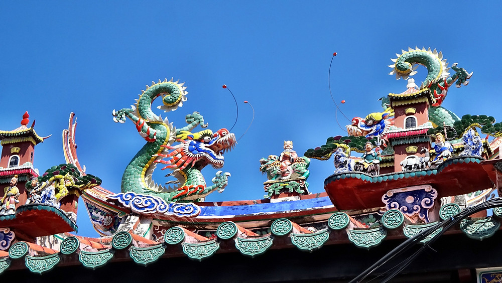 Exquisite ceramic roof with dragons on a Buddhist temple in George Town. These designs were made with thousands of pieces of broken ceramic dishes. These days, to repair these elaborate roofs, artisans from China must be recruited.