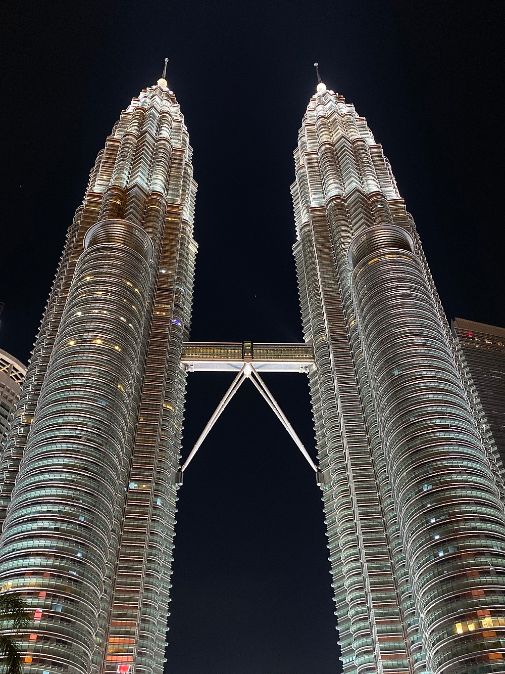 The beautiful Petronas Towers lit up at night. A two story skybridge connects the 41st and 42nd floors.