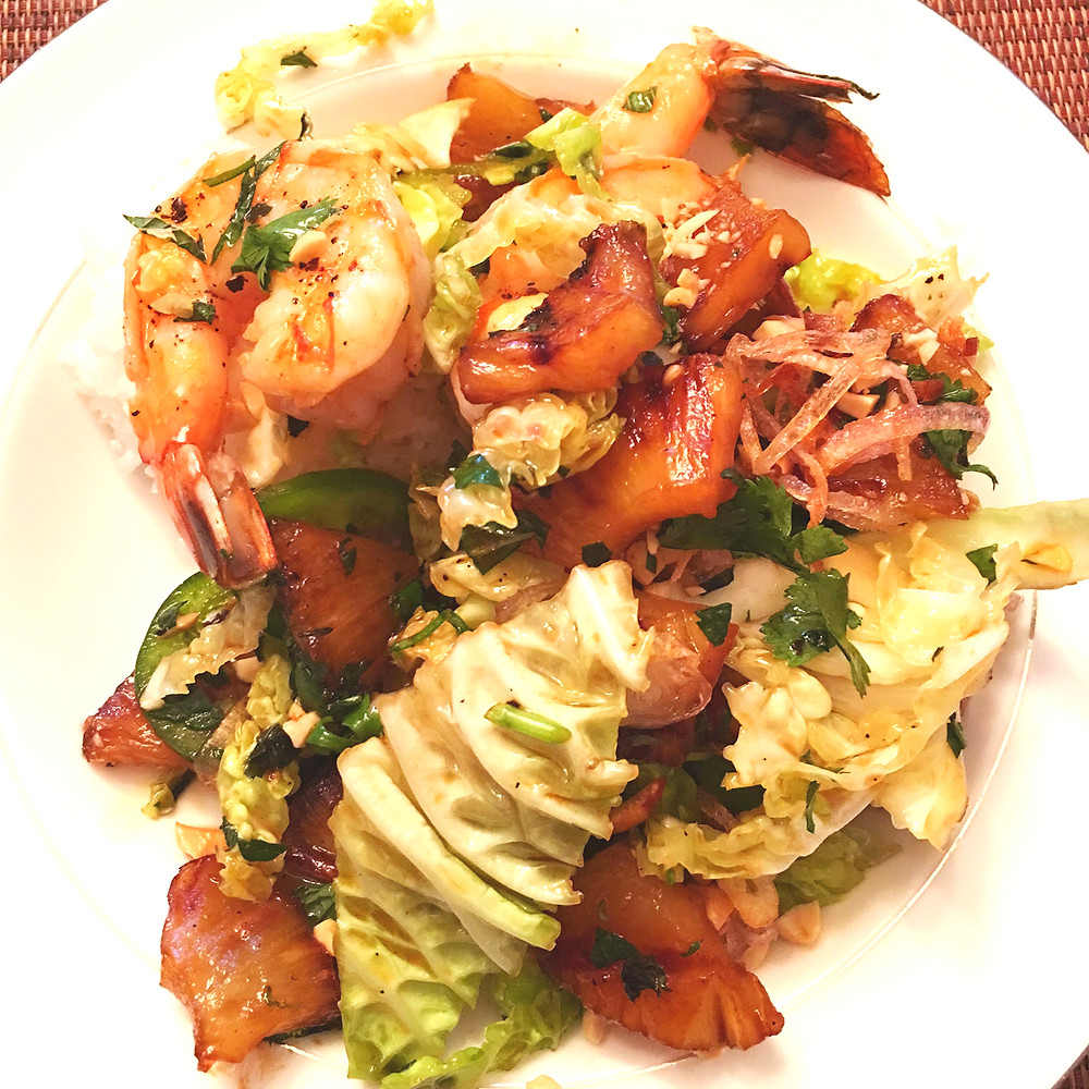 Caramelized pineapple and fried shallots and garlic provide an exciting take on salad