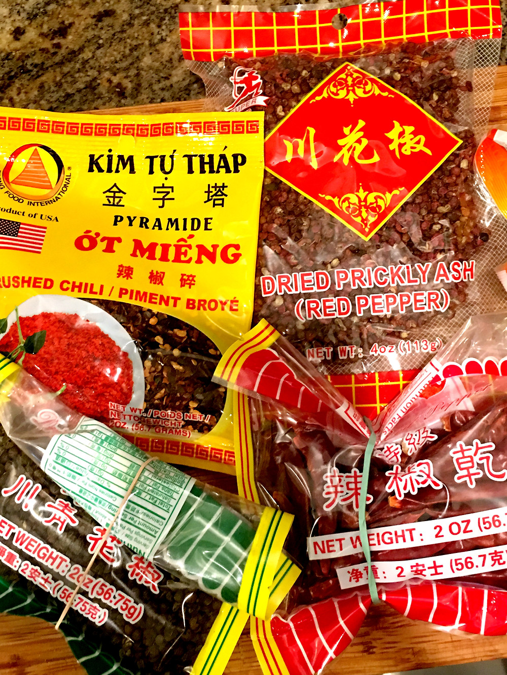 Ingredients for Sichuan Fried Chicken include Sichuan peppercorns, dried chilis, and chili flakes