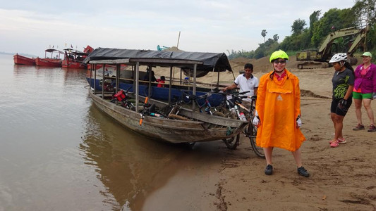 Boarding a ferry with our bikes in southern Laos
