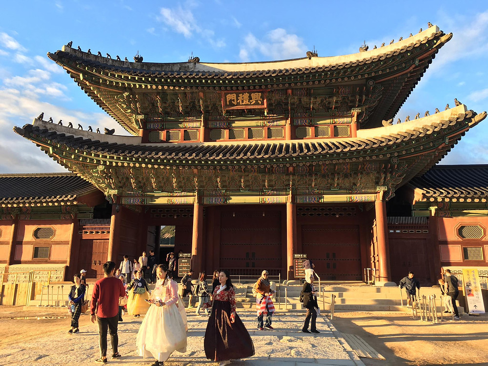Gyeongbokgung Palace in Seoul with tourists dressed in traditional costumes
