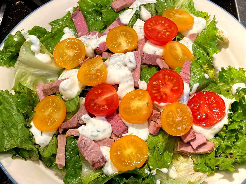 Turn leftover roast lamb into a Greek salad. Toss lettuce with a balsamic vinaigrette and top with tomatoes and tzatziki.