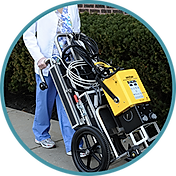 Doctor pushing x-ray generator on a cart