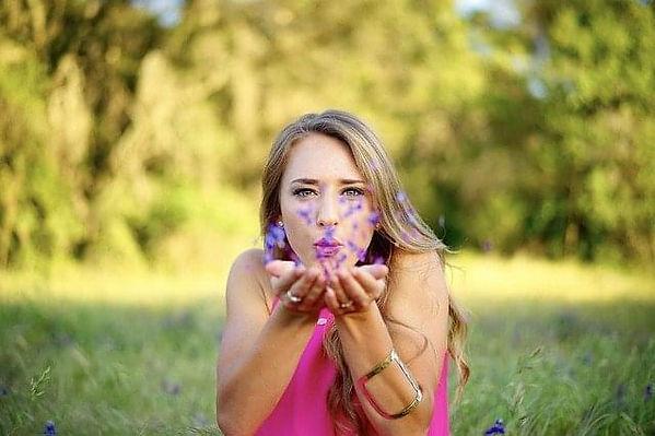girl blowing flowers.jpg