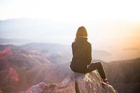 girl sitting on rock.jpg
