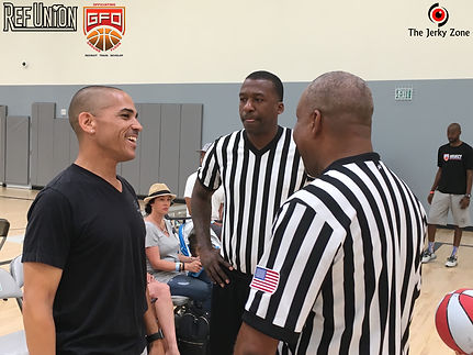Divsion 1 Pac-12 official Ken Nash discusses the basketball game with two grassroots youth referees.