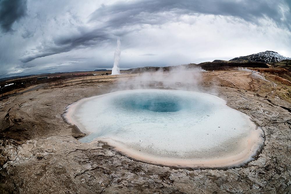 Strokkur erupting with Geysir in the foreground