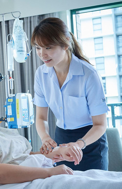 nurse_patient_bed_pulse_smile.jpg