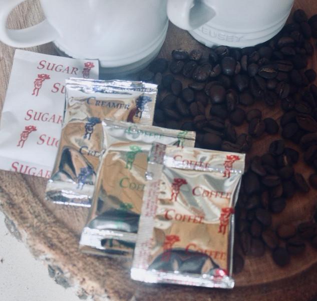 Coffee, creamer and sugar sachets
