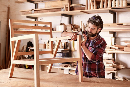 Serious furniture designer carefully san
