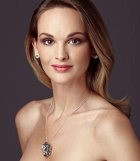 Ellen Kvam Jewellery model wearing rose pendant