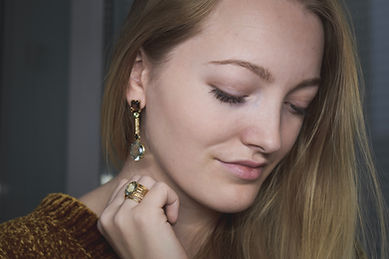 Jewellery model wearing natural gem stone earrings and ring