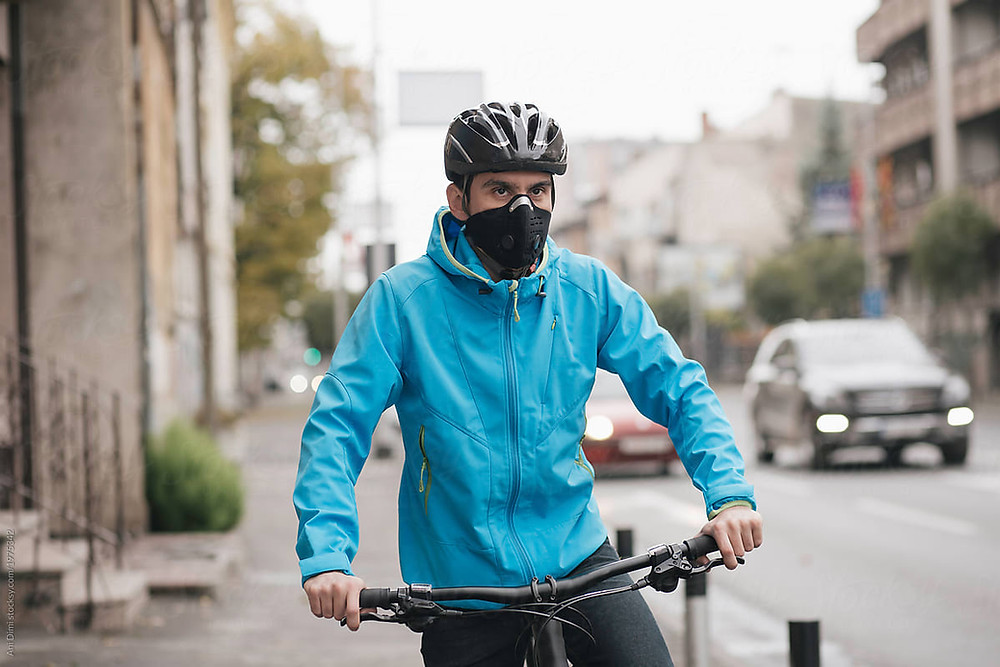 Road biker wearing a face mask outdoors