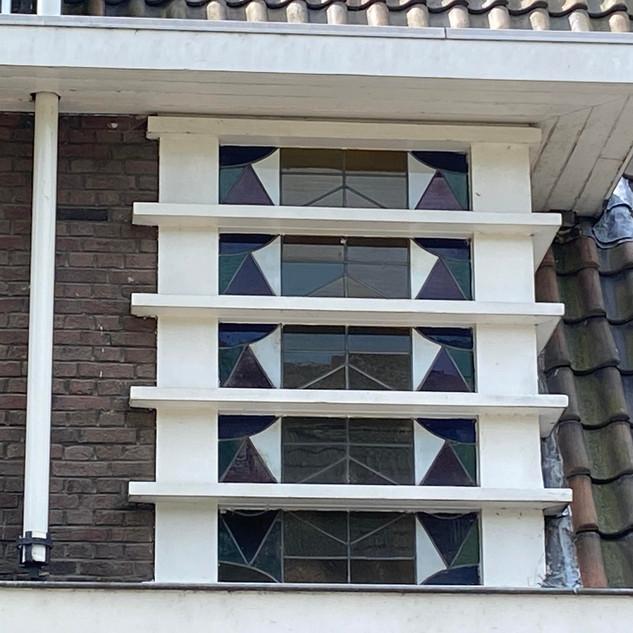 Motto- Amsterdamse school raam
