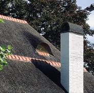 Motto- Dakkapel met schoorsteen als campanile