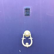 Motto- Paarse deur